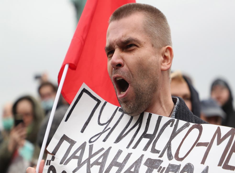 <p>A Russian Communist party supporter at the protest against election fraud in Moscow on Saturday</p>