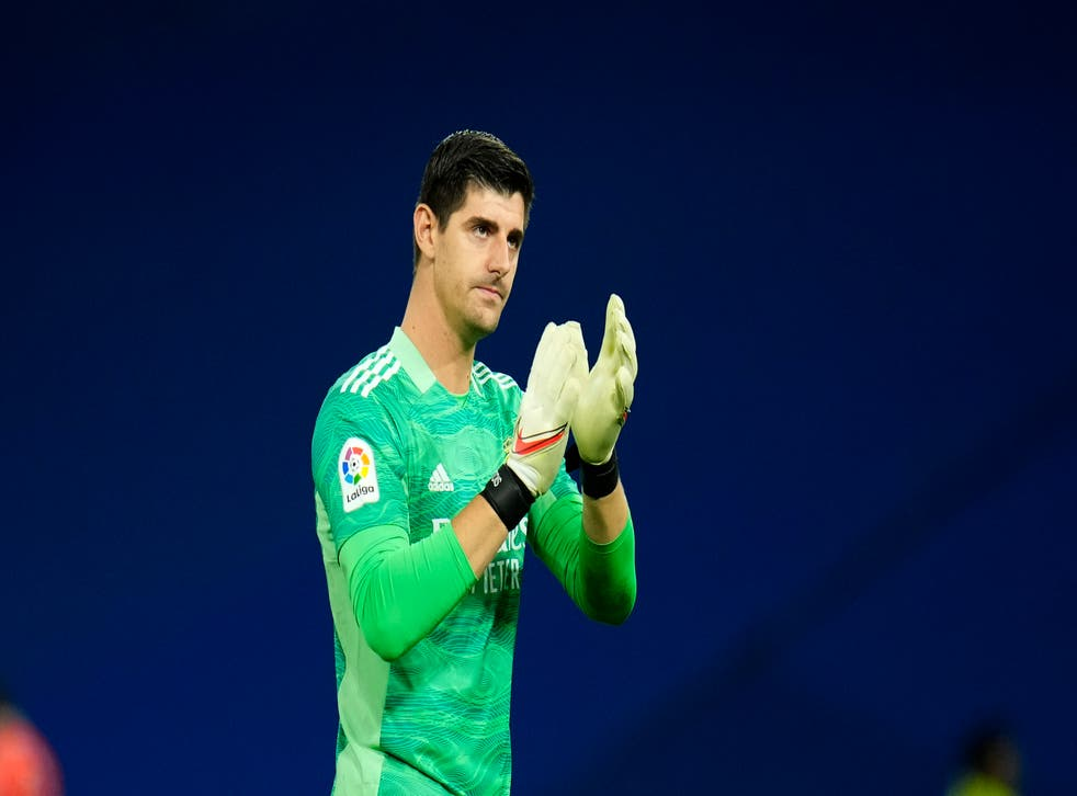 Real Madrid goalkeeper Thibaut Courtois made an important save in the first half (Manu Fernandez/AP)