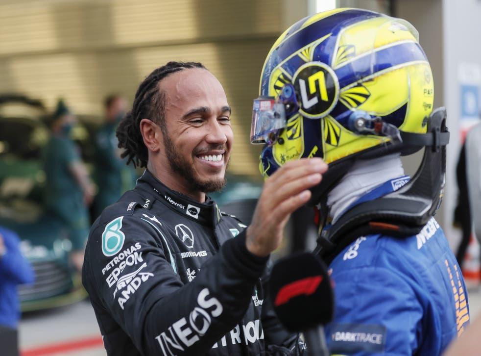 <p>Lewis Hamilton is congratulated by Lando Norris</p>