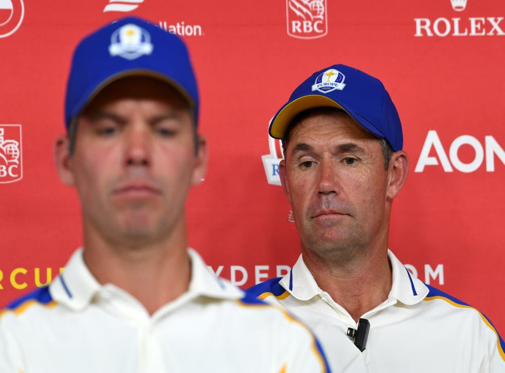 Team Europe captain Padraig Harrington, at right alongside Paul Casey, during a press conference after their heavy defeat to Team USA (Anthony Behar/PA)