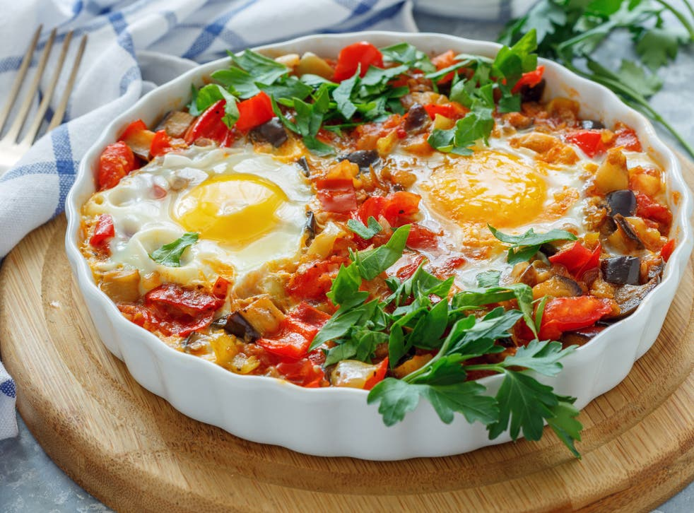 <p>Meltingly soft: spiced aubergine and tomatoes with runny eggs</p>