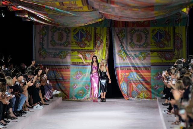 Dua Lipa, left, and Donatella Versace at the Versace show at Milan Fashion Week (Luca Bruno/AP)