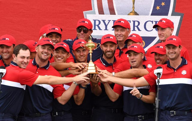 Team USA team celebrate with the Ryder Cup trophy after victory against Team Europe at Whistling Straits (Anthony Behar/PA)