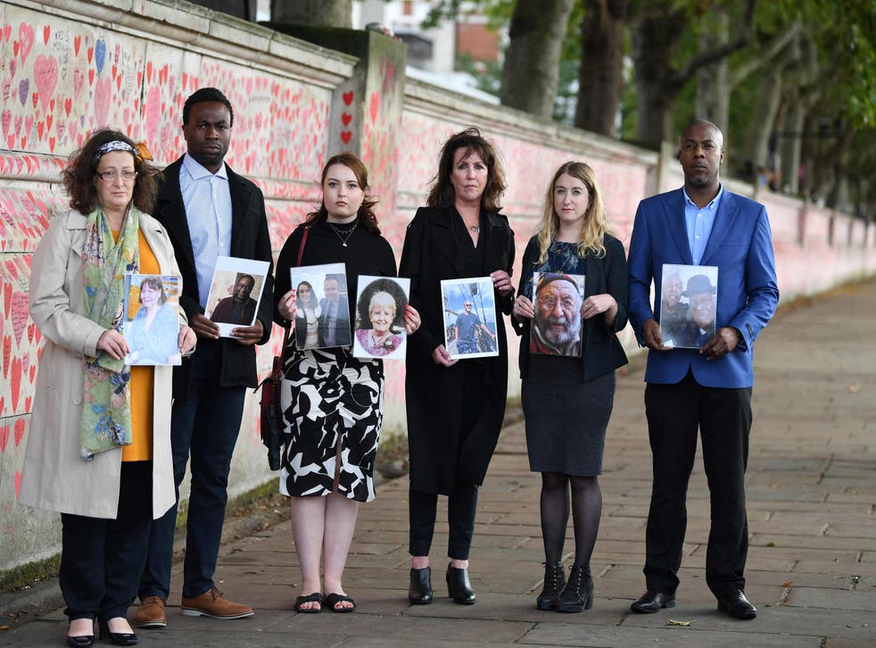 <p>Members of the Covid-19 Bereaved Families for Justice group, from left, Deborah Doyle, Lobby Akinnola, Hannah Brady, Fran Hall, Jo Goodman and Charlie Williams, hold photos of loved ones who died of coronavirus </p>