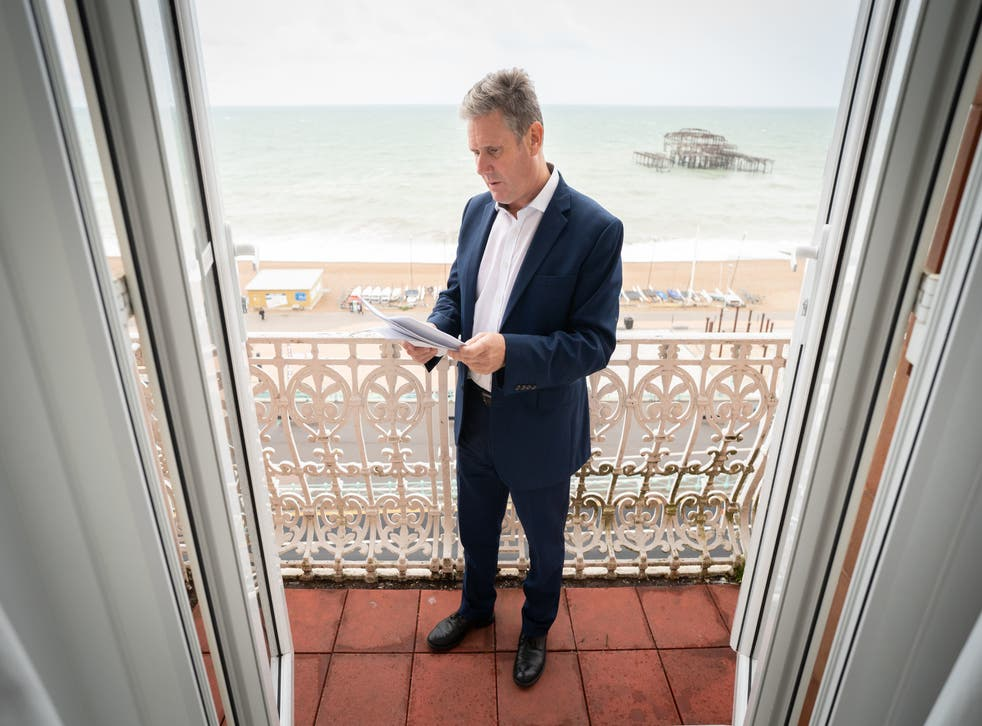 <p>Sir Keir Starmer prepares his Labour Party conference speech in his hotel room in Brighton yesterday </p>