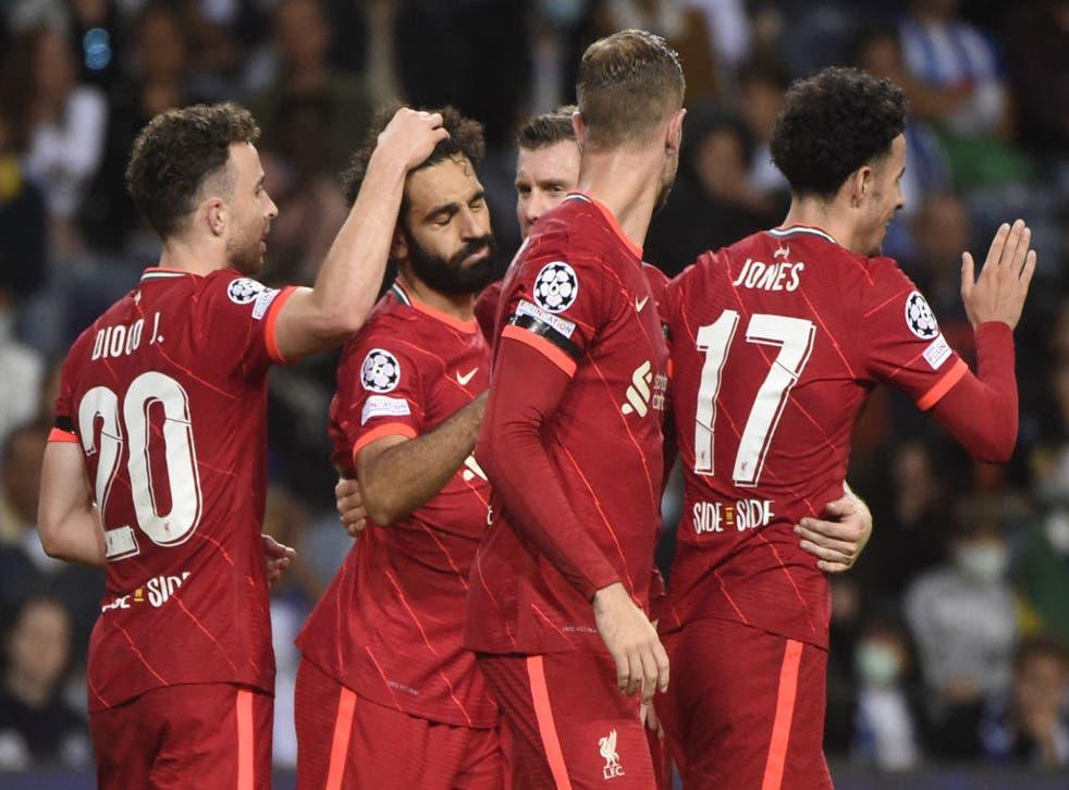 <p>Mohamed Salah celebrates with his teammates after scoring</p>