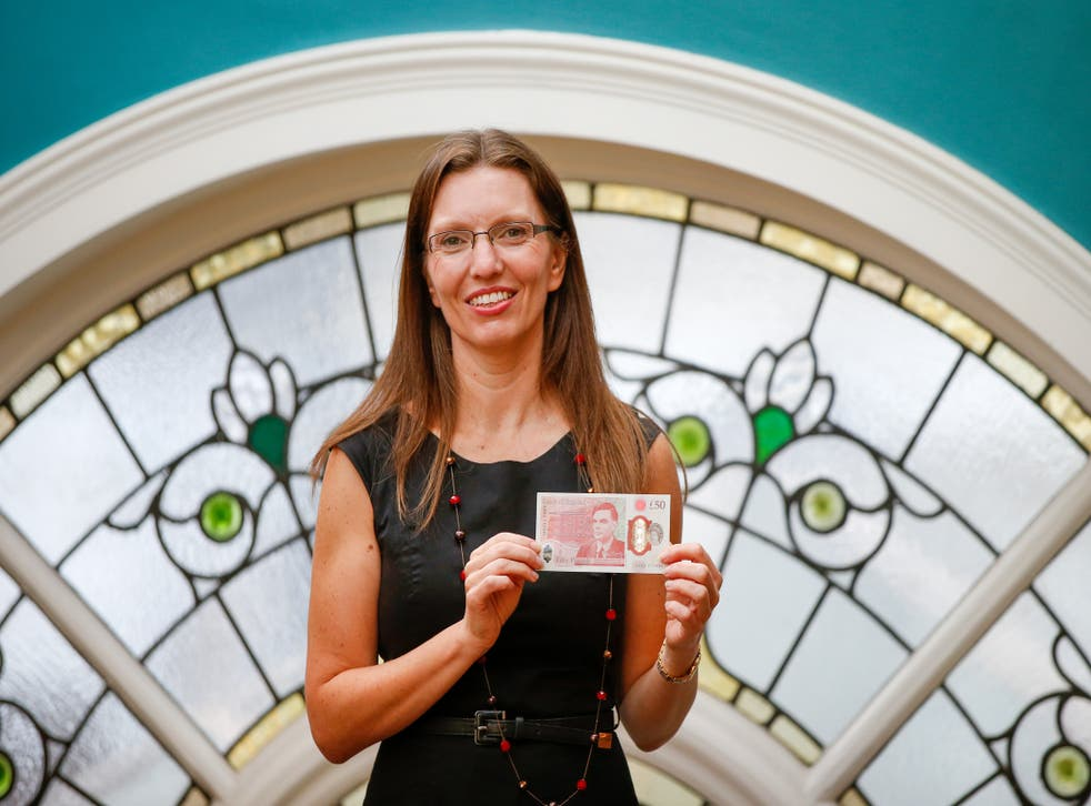 Sarah John, chief cashier of the Bank of England, with a new £50 banknote in June 2021 (Hollie Adams/PA)