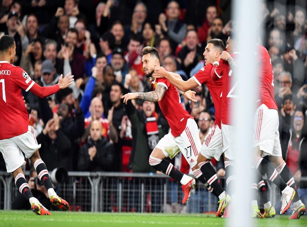 <p>Alex Telles celebrates his stunning volley</p>