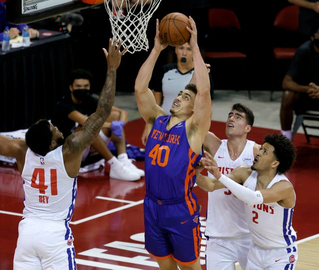 <p>Reid Travis of the New York Knicks shoots against Saddiq Bey, Luka Garzaz and Cade Cunningham of the Detroit Pistons during the 2021 NBA Summer League at the Thomas & Mack Center on 13 August 2021 in Las Vegas, Nevada</p>