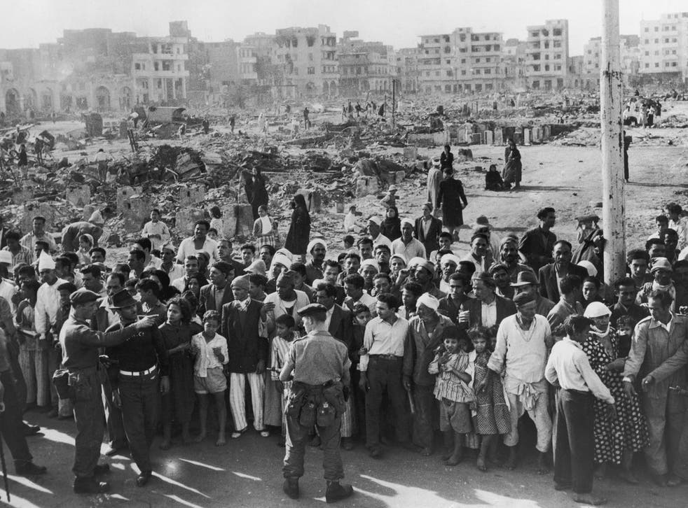 <p>12 November 1956: British soldiers supervise a crowd in Port Said while food is distributed during the Suez Crisis</p>