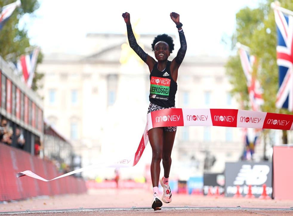 <p>Joyciline Jepkosgei celebrates winning the women's elite race during the 2021 Virgin Money London Marathon on Sunday </p>