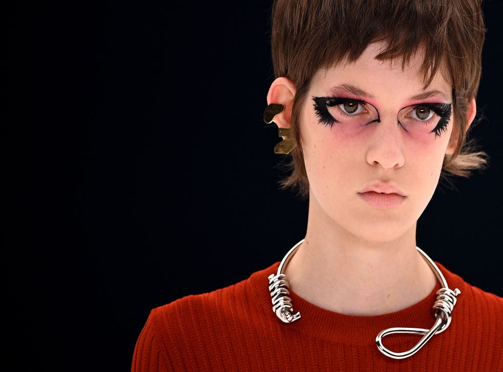 <p>The controversial necklace on the catwalk</p>