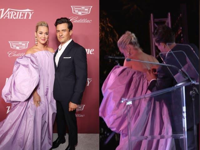 Orlando Bloom ayuda a Katy Perry a subir al escenario con su vestido