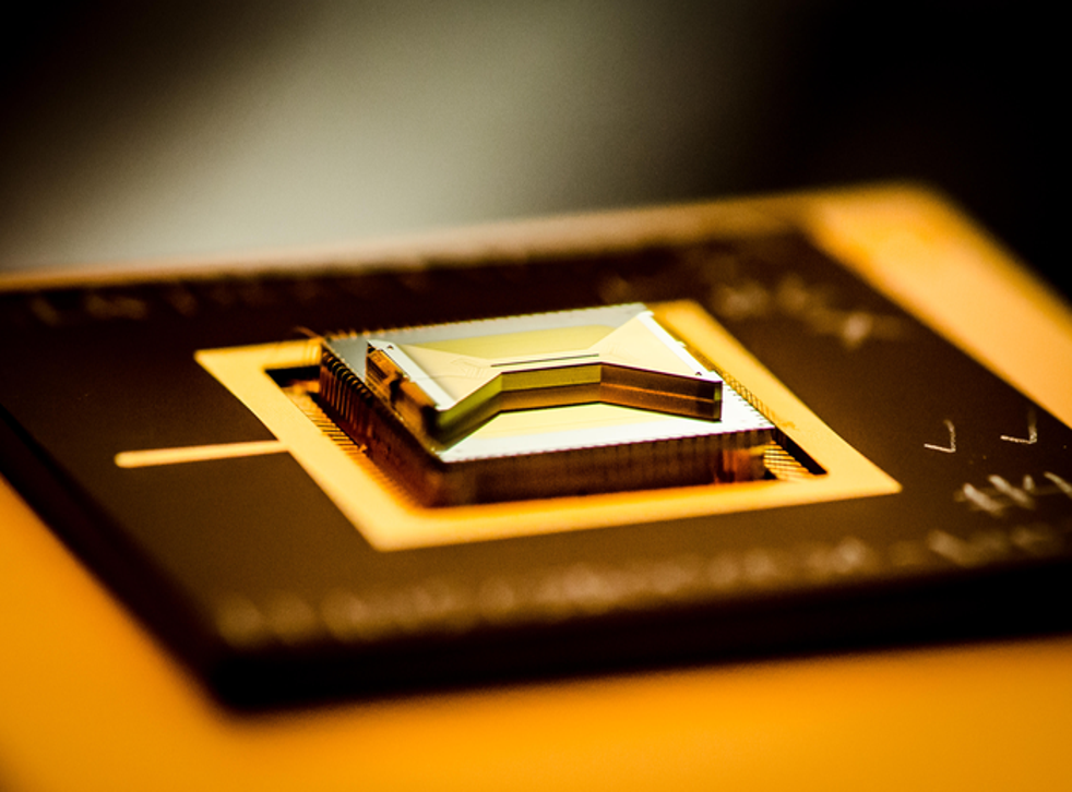 <p>A chip containing an ion trap that researchers use to capture and control atomic ion qubits (quantum bits).</p>