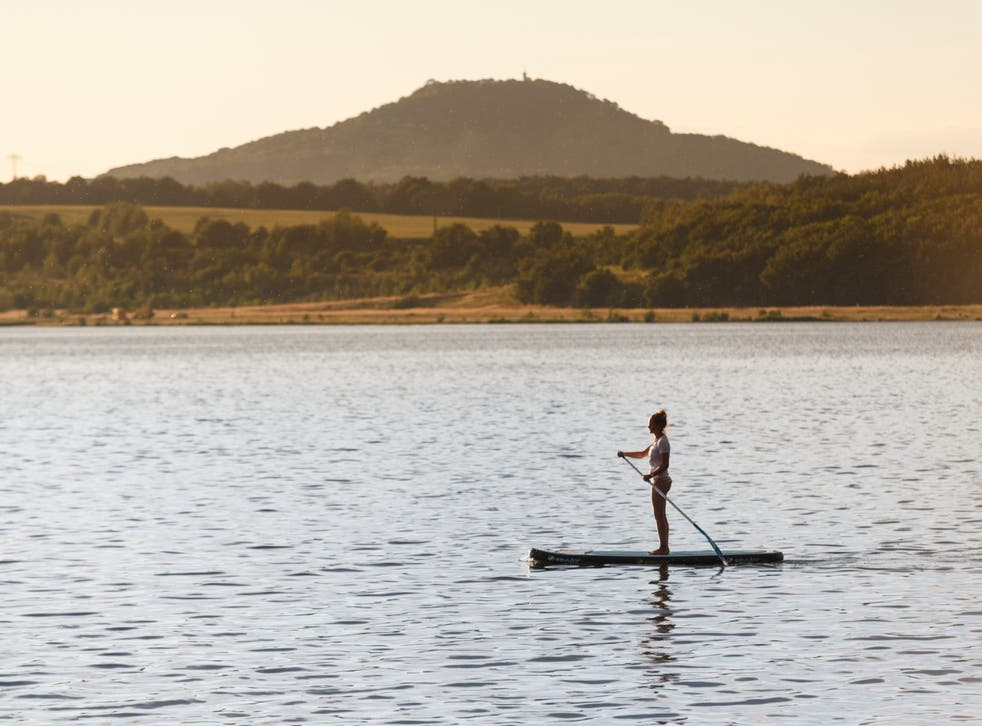 <p>A paddle boarder on the tranquil, man-made Berzdorfer lake </p>