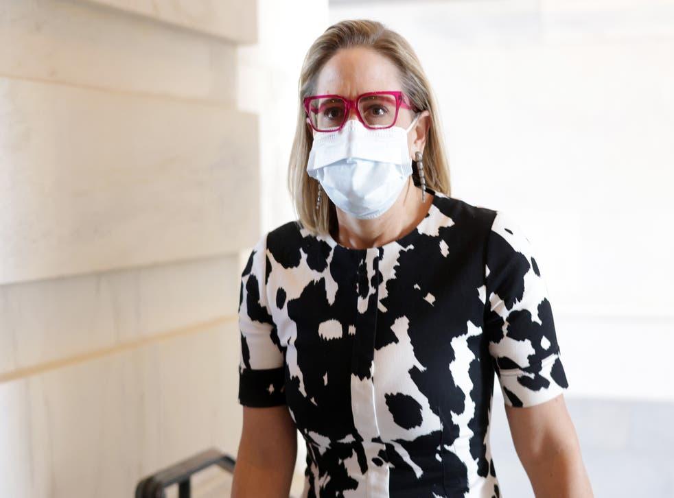 <p>US Sen Kyrsten Sinema (D-AZ) arrives at the US Capitol for a vote 29 September 2021 in Washington DC.</p>