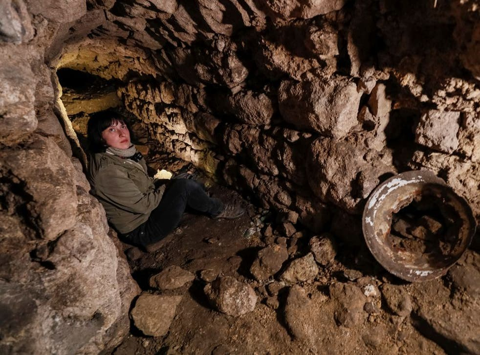 <p>Historian Hanna Tychka explores a cave at the city sewage system where dozens of Jews were hiding from the Nazis during World War Two in Lviv, Ukraine Garanich</p>
