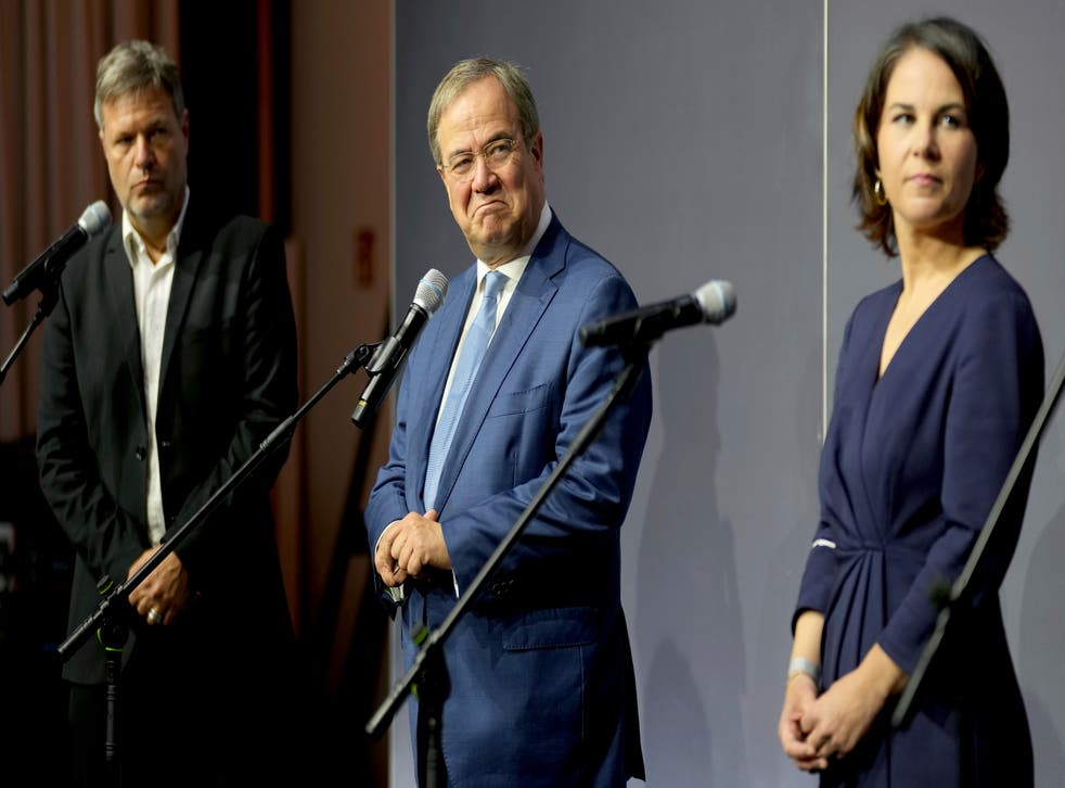 <p>From left, Robert Habeck, co-chairman of the German Green party (Die Gruenen), Armin Laschet, chairman of the German Christian Democratic Party (CDU), and Annalena Baerbock, co-chairwoman of the German Green party (Die Gruenen), attend a statement after a meeting in Berlin, Germany, Tuesday, Oct. 5, 2021. </p>