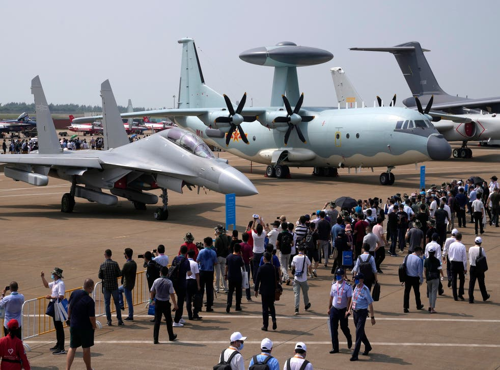 <p>File photo. Visitors view the Chinese military's J-16D electronic warfare airplane, left, and the KJ-500 airborne early warning and control aircraft at right during 13th China International Aviation and Aerospace Exhibition on 29 September in Zhuhai in southern China's Guangdong province</p>