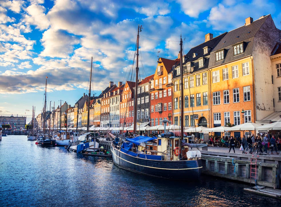 <p>Traditional houses in Copenhagen old town Nyhavn at sunset </p>