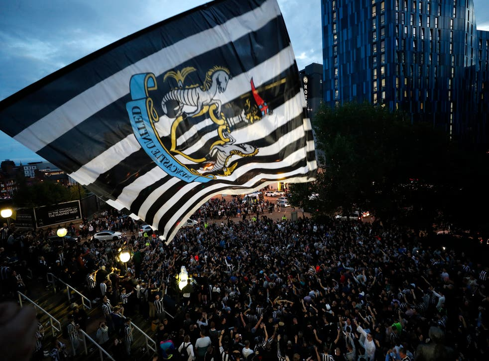 <p>Newcastle fans celebrate the takeover at St James' Park</p>