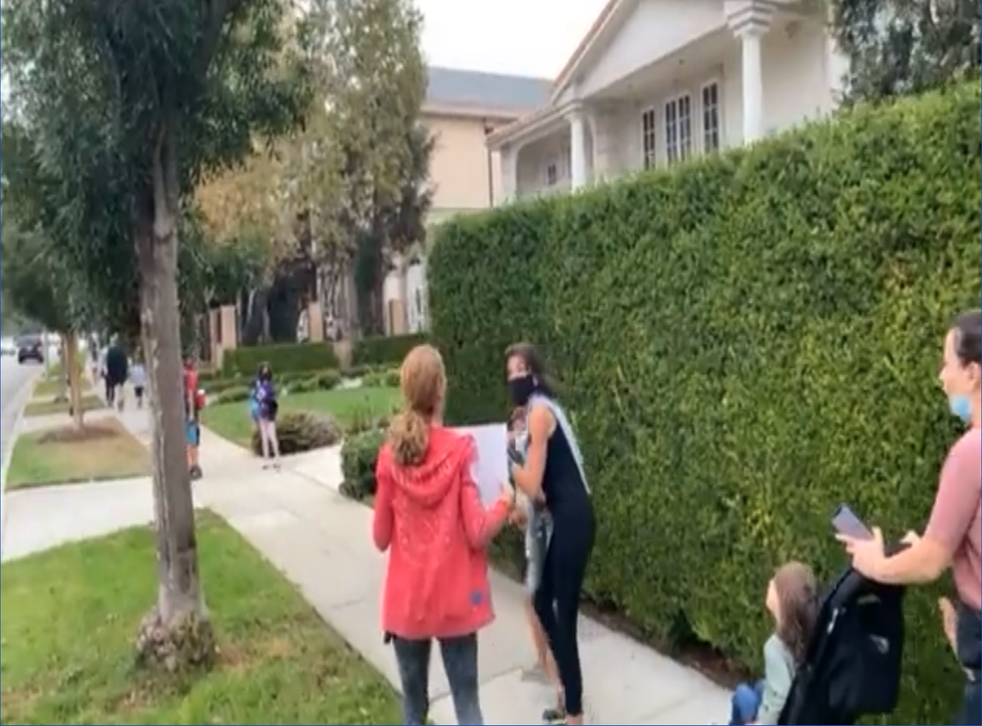 <p>Protesters confront parents walking their kids to primary school in an upscale neighbourhood of Los Angeles. </p>