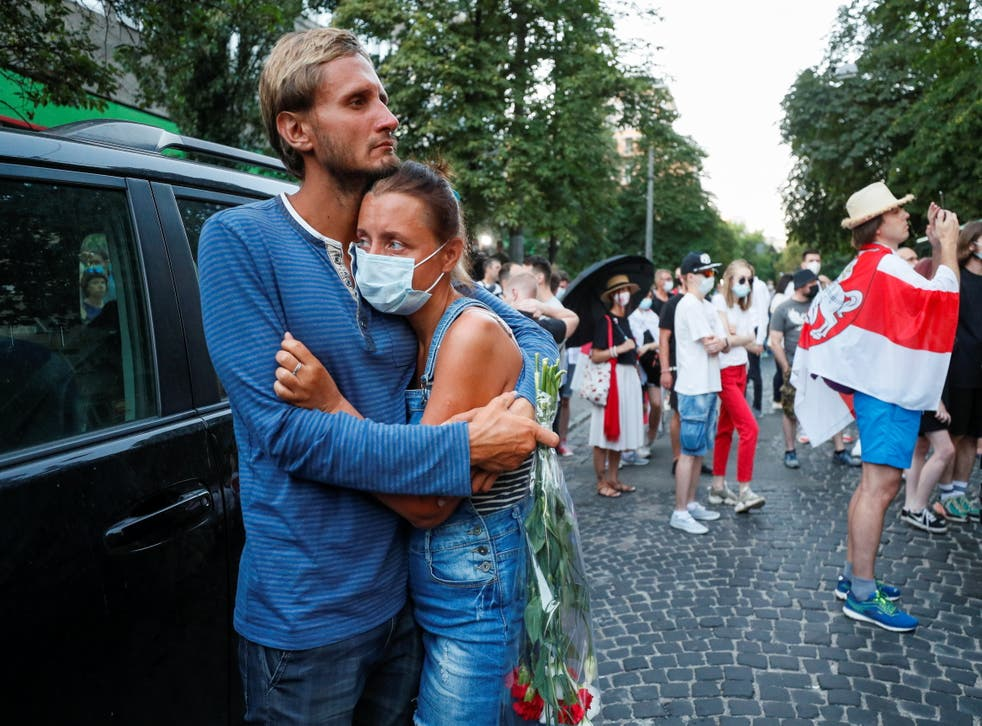 <p>People attend a rally next to the Belarusian Embassy to Ukraine to commemorate Vitaly Shishov, a Belarusian activist living in exile who was found hanged in a park near his home in August</p>
