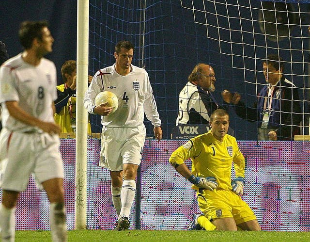 Paul Robinson, right, looks dejected after his goalkeeping clanger (Owen Humphreys/PA)