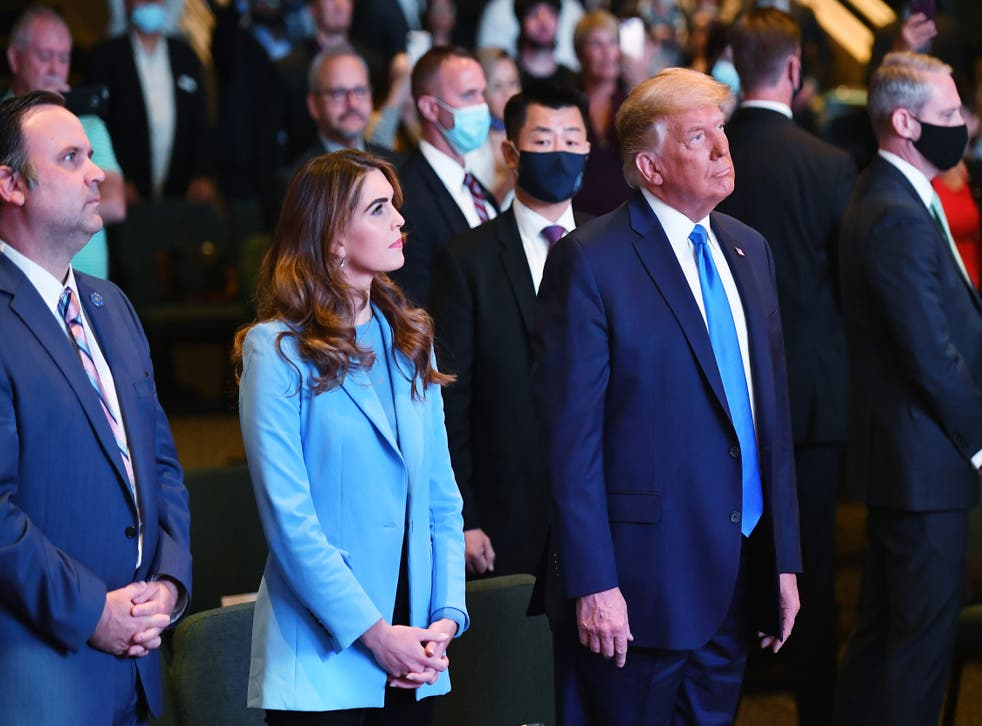 <p>Hope Hicks, senior adviser to the president, and White House Deputy Chief of Staff for Communications Dan Scavino(L) attend services with US President Donald Trump at the International Church of Las Vegas in Las Vegas, Nevada, on October 18, 2020. </p>