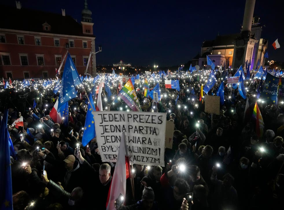 <p>One protester holds up a sign that reads: 'One leader, one party, one creed. Once it was Stalinism, now it it's Kaczynski-ism' </p>