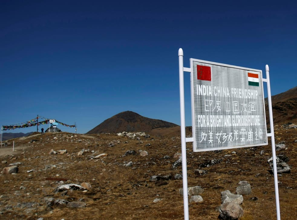 <p>A signboard is seen from the Indian side of the Indo-China border at Bumla in Arunachal Pradesh</p>