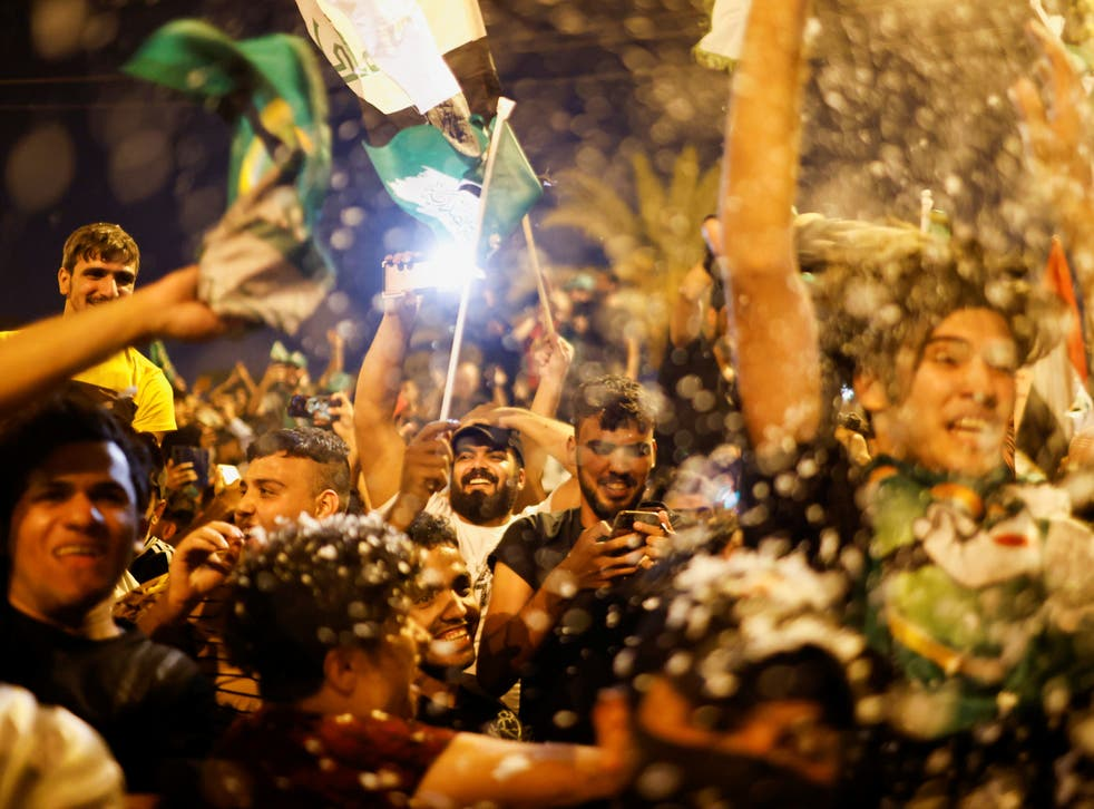 <p>Supporters of Sadr's movement celebrate after preliminary results of Iraq's parliamentary election were announced in Baghdad</p>