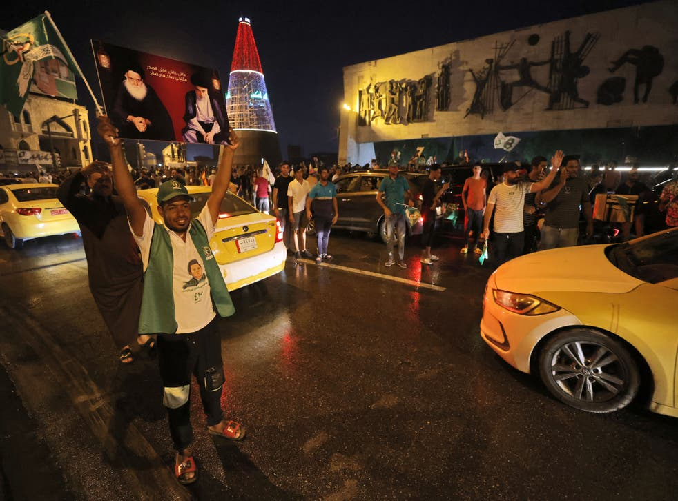 <p>Supporters of Iraqi Shia cleric Muqtada al-Sadr celebrate in Baghdad's Tahrir Square </p>