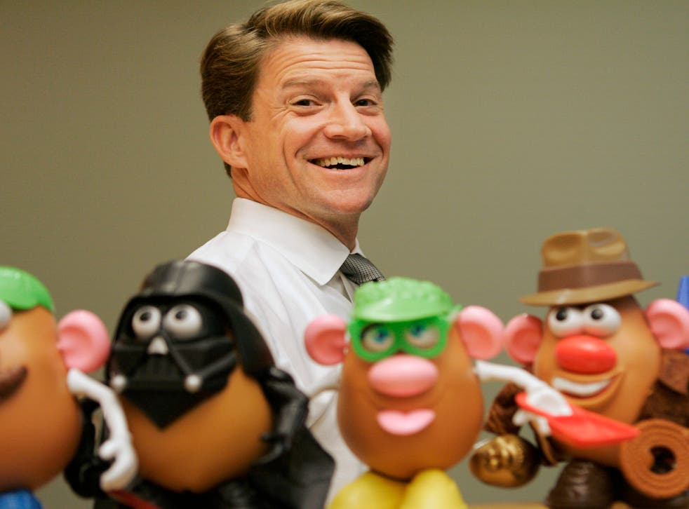 <p>In this 2008 file photo, Brian Goldner stands next to some toy figures at Hasbro's headquarters, in Pawtucket, Rhode Island </p>