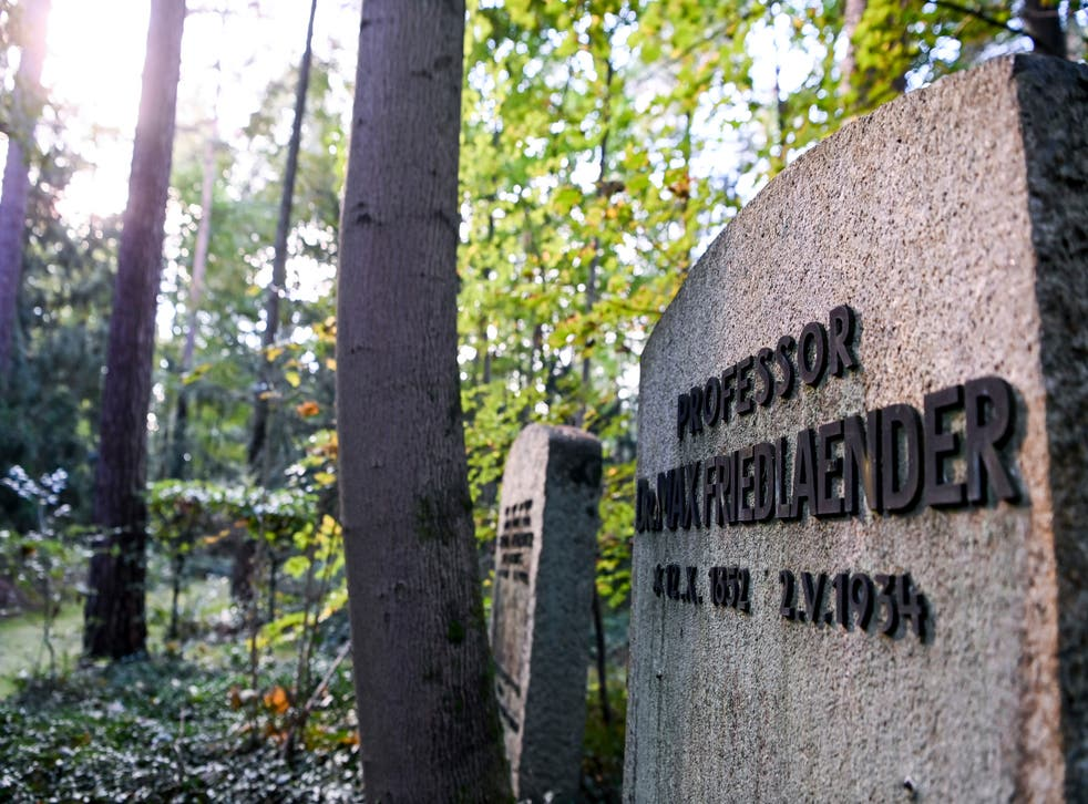 <p>This 12 October 2021 taken photo shows the grave of Max Friedlaender, a musicologist of Jewish faith at the Suedwestkirchhof Stahnsdorf, Germany. The German government's top official against antisemitism on Wednesday criticized the burial of a Holocaust denier on the former gravesite of a known Jewish musicologist</p>