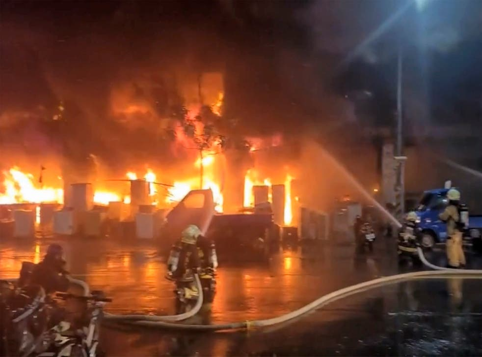 <p>Officials said that the fire has been put out but not before it destroyed much of the building, covering lower floors in black soot</p>