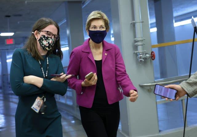 <p>Sen Elizabeth Warren speaks to reporters on Capitol Hill</p>