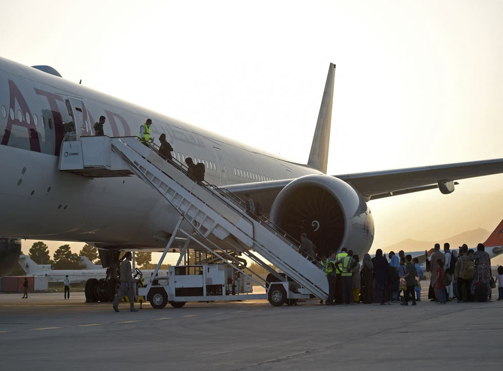 <p>A file photo of passengers leaving Kabul airport on Qatar Airways last month</p>