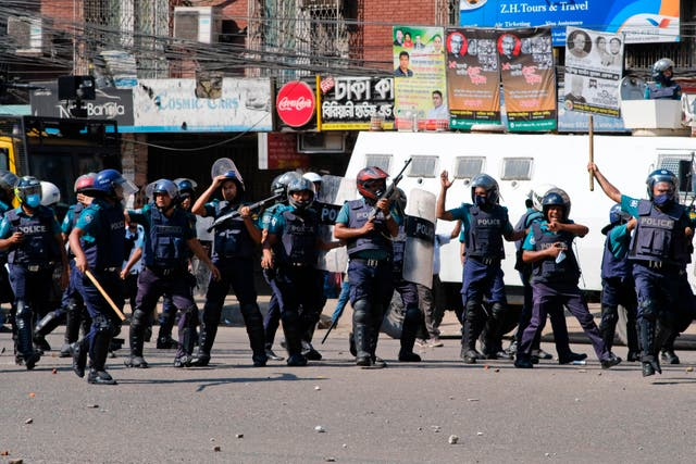 <p>Police clash with Muslim devotees during a protest  over an alleged insult to Islam, outside the country' main Baitul Mukarram Mosque in Dhaka</p>