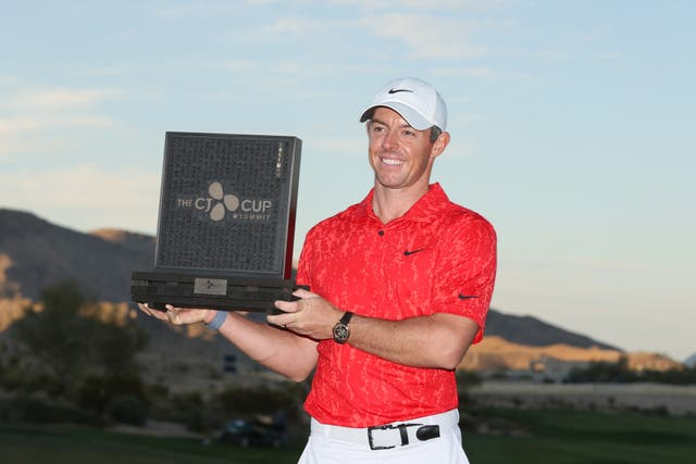 <p>Rory McIlroy of Northern Ireland celebrates with the trophy</p>