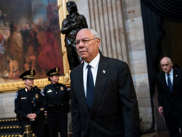<p>Colin Powell arrives to pay his respects at the casket of the late former president George HW Bush as he lies in  in 2018 </p>