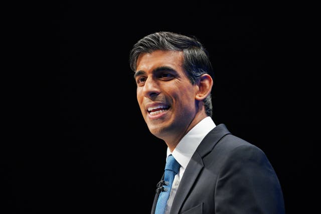 Chancellor Rishi Sunak is reportedly planning to more than halve the tax surcharge on bank profits (Peter Byrne/PA)
