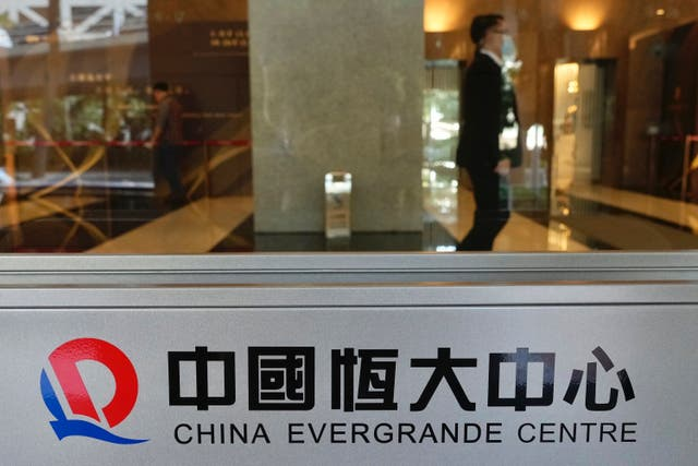 <p>File photo: China's indebted property developer Evergrande has liabilities worth 1.97 trillion yuan (around £220bn) </p>