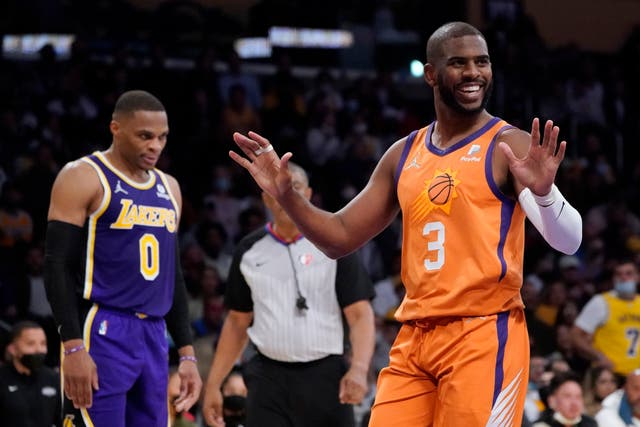 Phoenix Suns guard Chris Paul (3) argues a call during the first half of an NBA game against the Los Angeles Lakers (Marcio Jose Sanchez/AP)