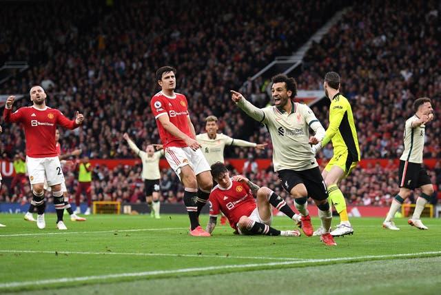 <p>Mohamed Salah celebrates scoring Liverpool's third</p>