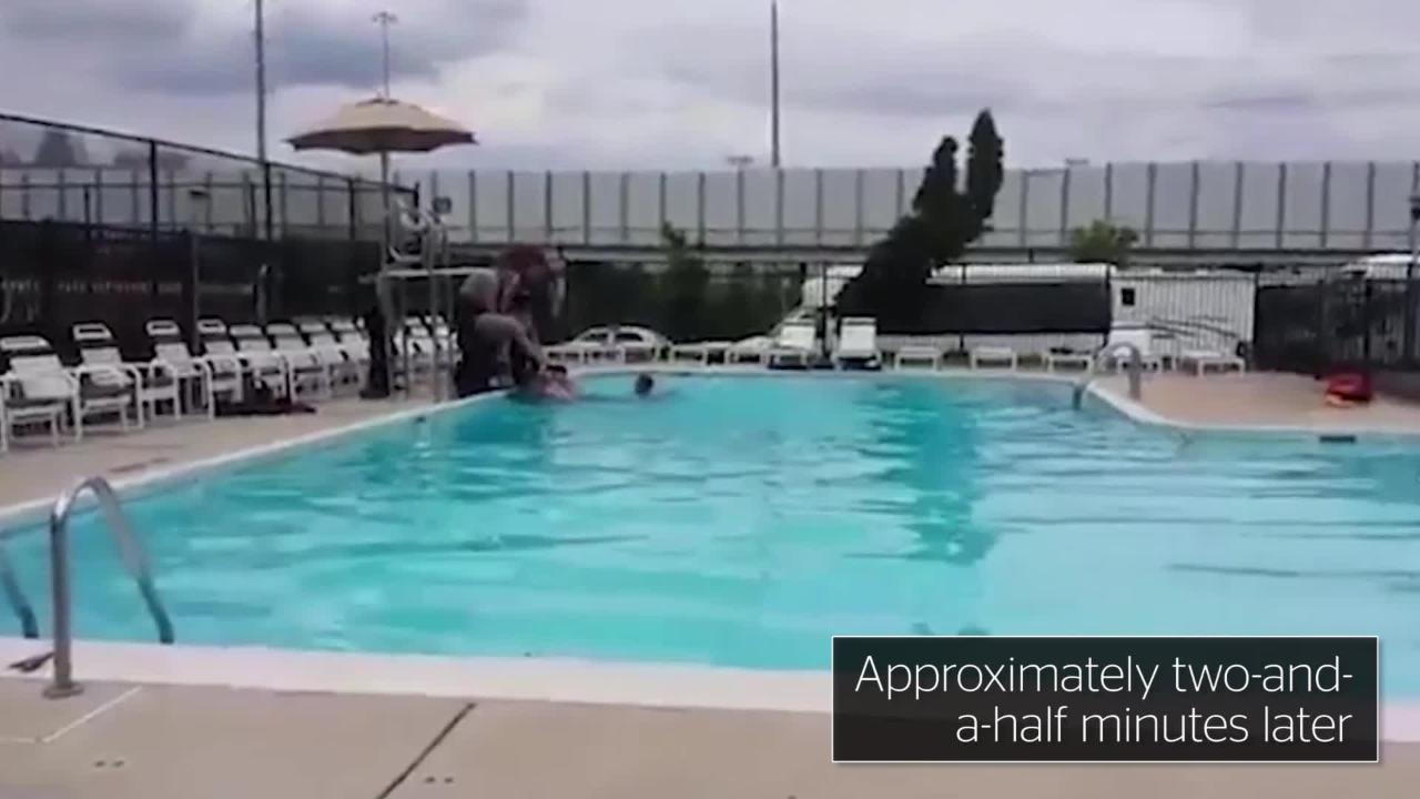 Two men pounding in the pool