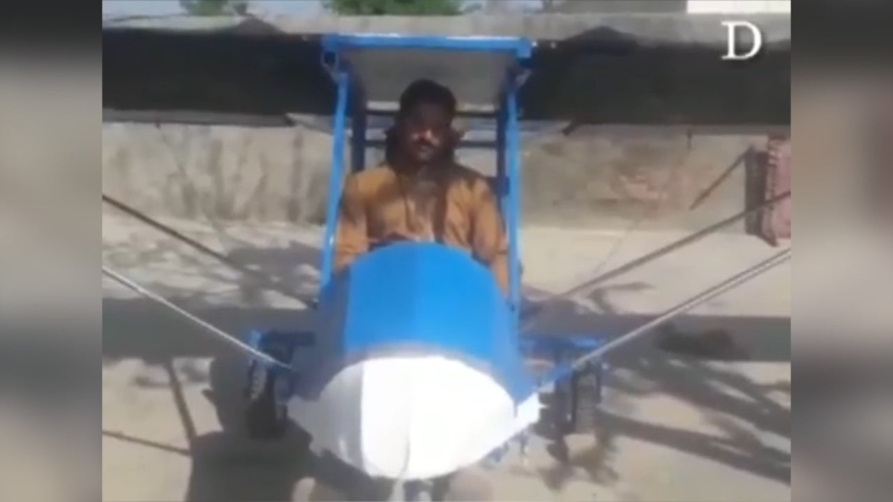 Man builds homemade plane then uses road as runway to take off as hundreds watch in delight