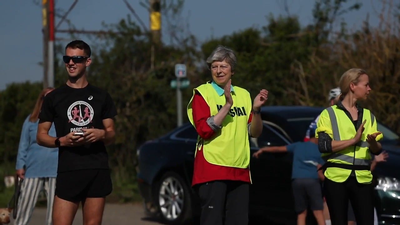 Theresa May spotted in yellow vest working as marshal at Easter race