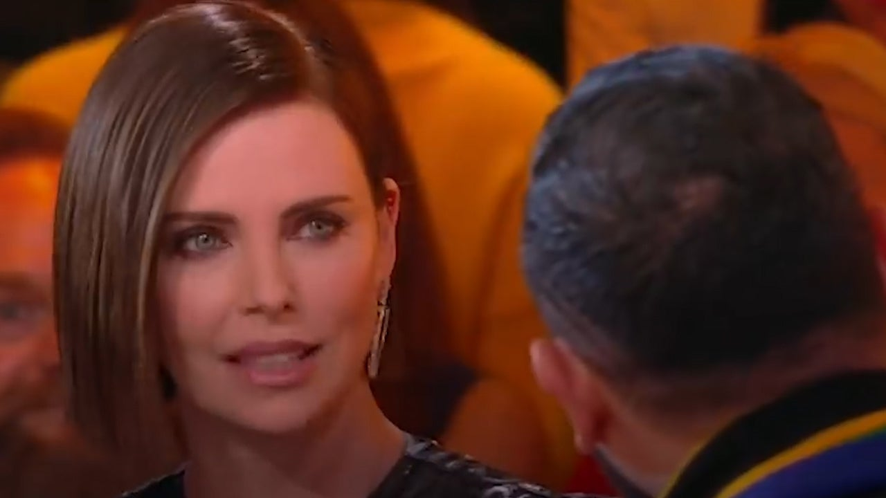Charlize Theron reacts to French TV presenter kissing her interpreter without consent