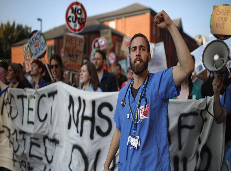 NHS workers take part in an anti-austerity protest on 4 October 2015 in Manchester